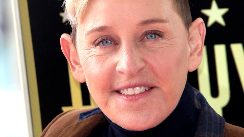 Ellen DeGeneres posing at event