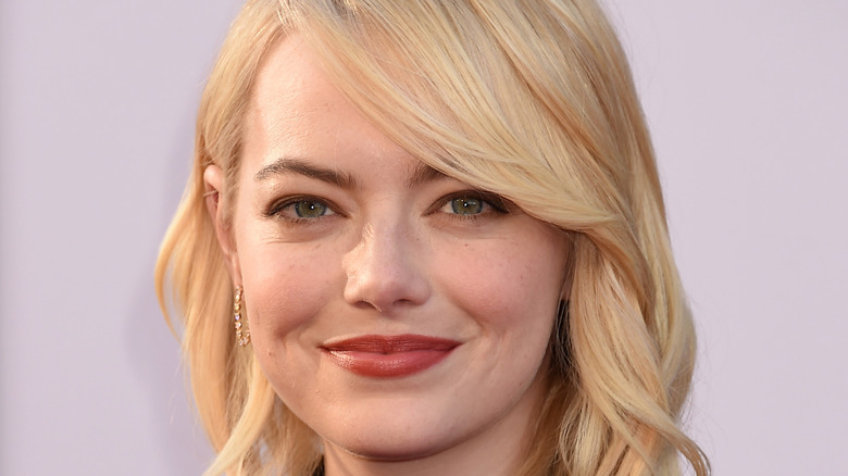 Blonde haired Emma Stone smiling for the camera