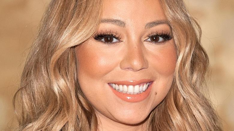 Mariah Carey smiling at an event