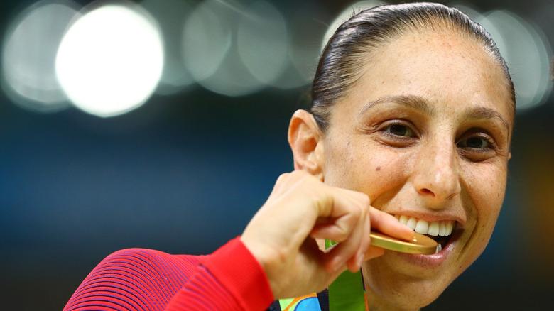 Olympian Diana Taurasi chews on her medal