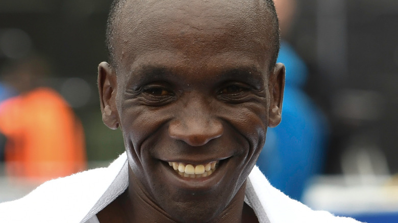 Runner Eliud Kipchoge smiles after competing