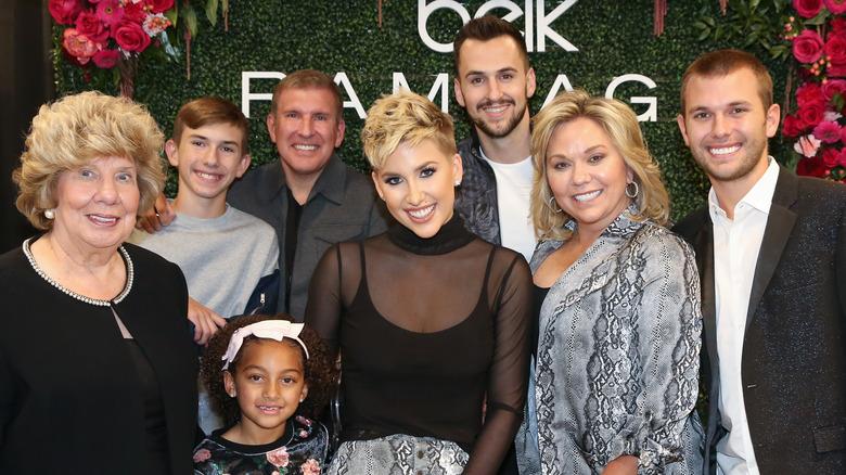The Chrisley family pose at an event for Savannah Chrisley