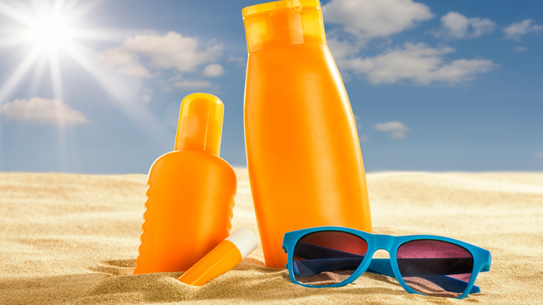 sunscreen products in the sand