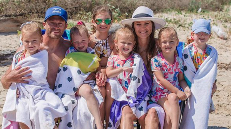 Adam and Danielle Busby take their daughters to the beach.