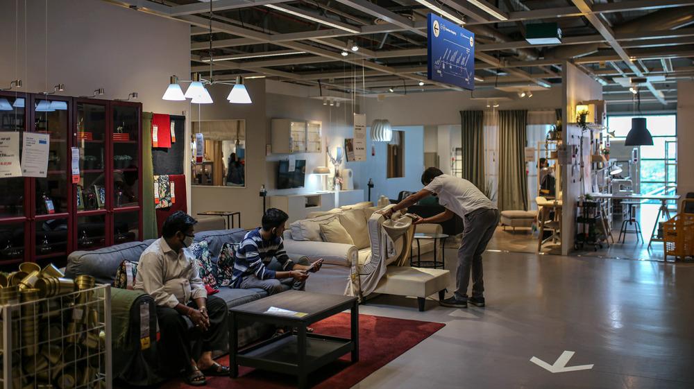 IKEA customers inspecting furniture