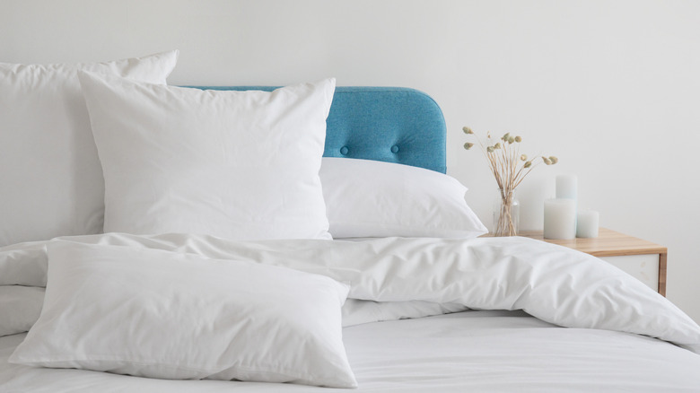 A bed with a blue headboard