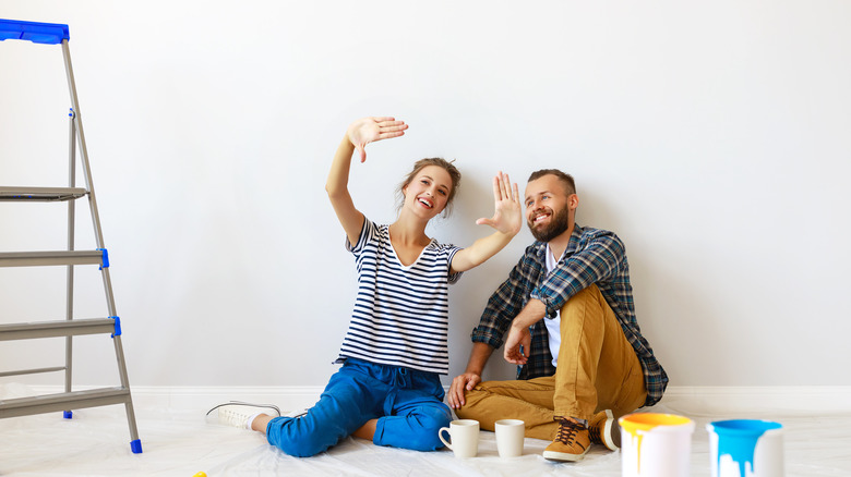 couple planning a design project and paint color