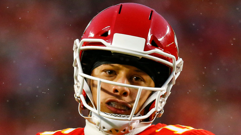Patrick Mahomes throws the ball on the field