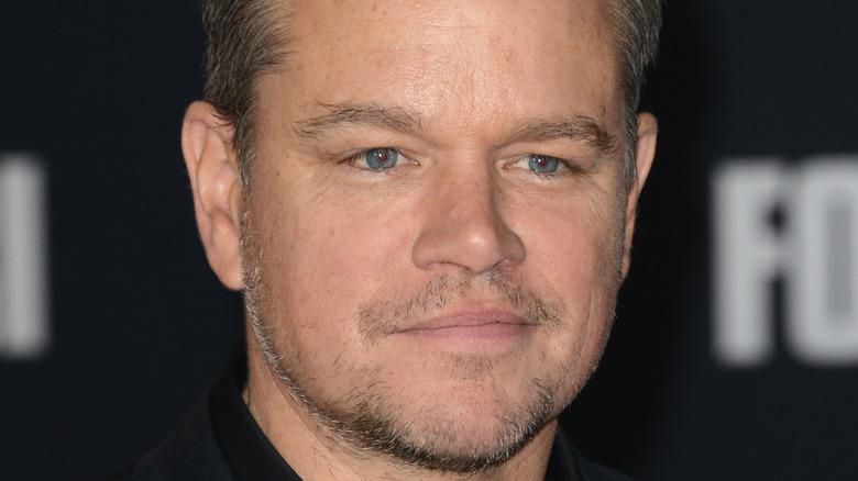 Matt Damon grinning with facial scruff