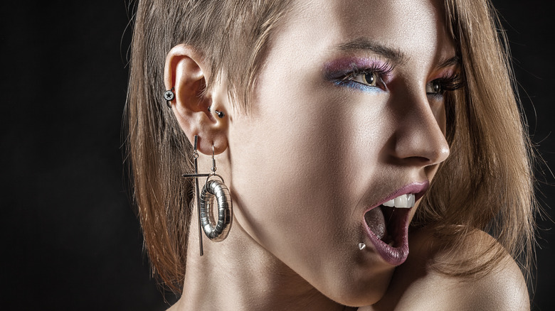 Woman with body piercings