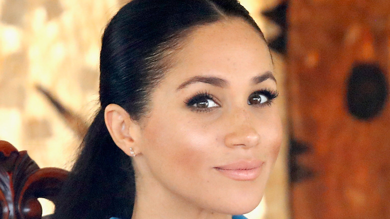 Meghan Markle looks knowingly at the camera