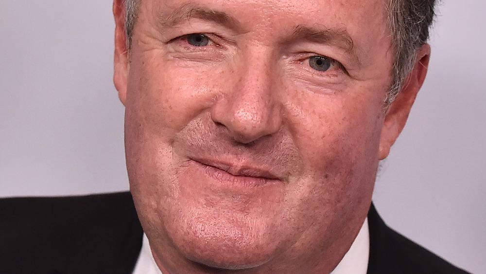 Piers Morgan slightly smiling