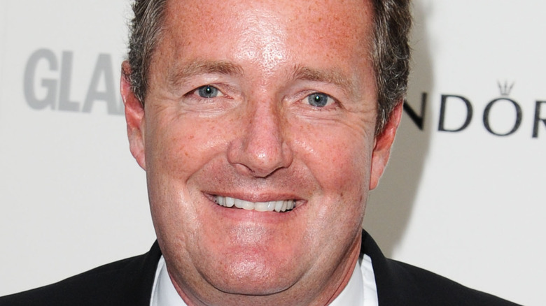 Piers Morgan smiles on the red carpet