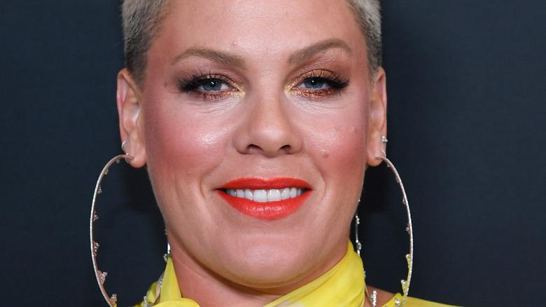 Pink smiling with large hoop earrings