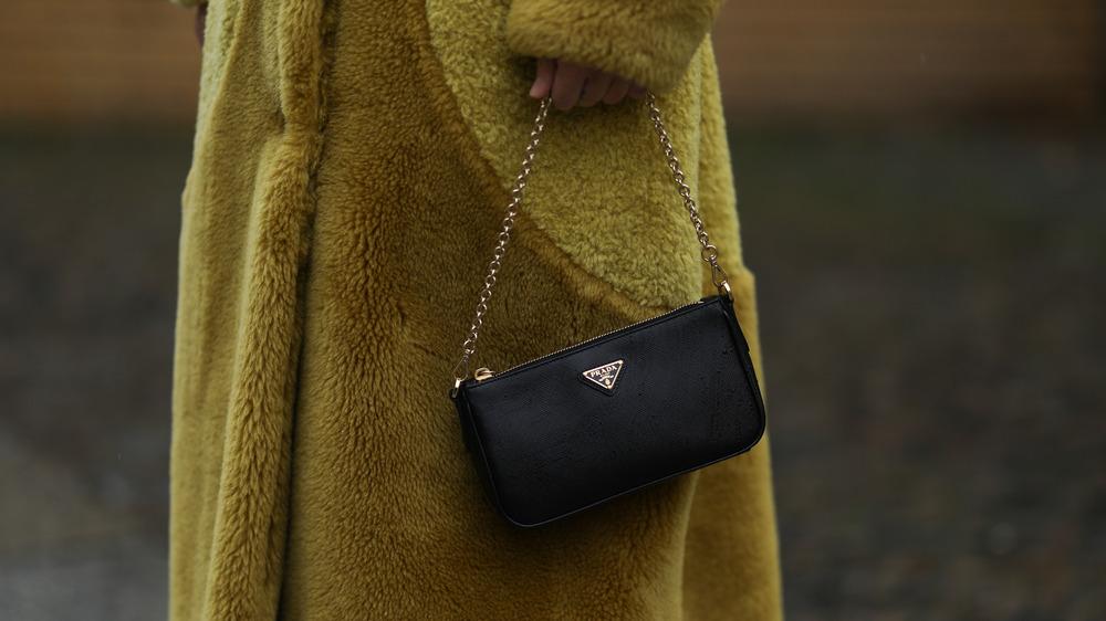 Woman holding Black Prada bag