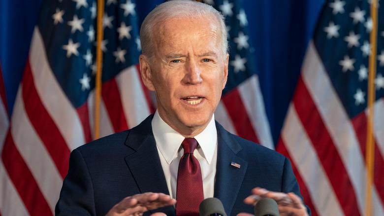 Joe Biden in front of American flags