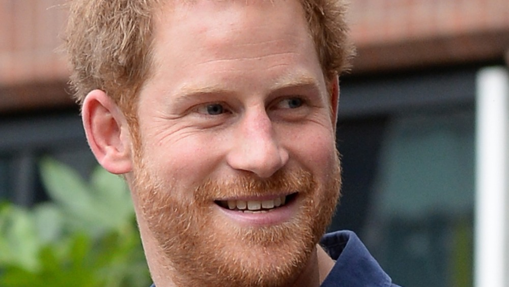 Prince Harry smiling with beard