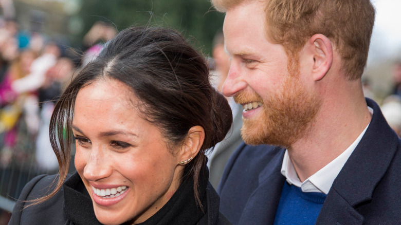 Prince Harry and Meghan Markle with crowds