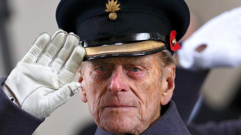 Uniformed Prince Philip saluting