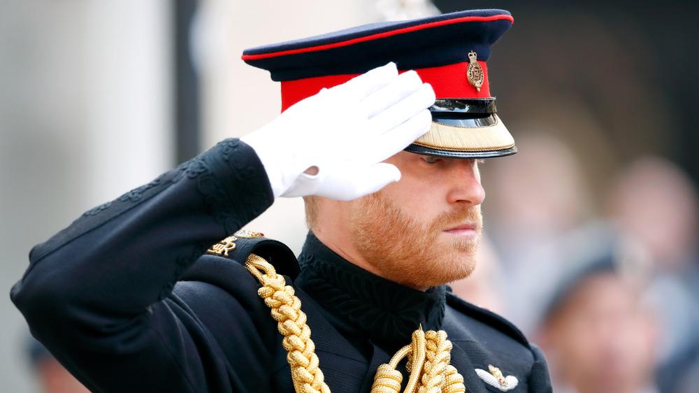 Prince Harry saluting in uniform