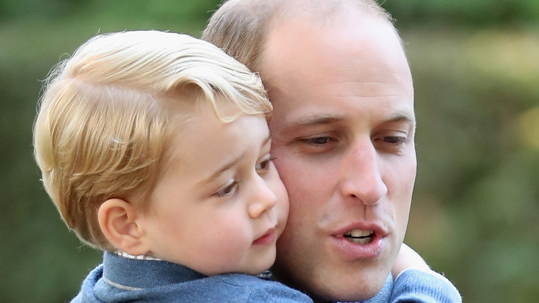 Prince William and Prince George embracing