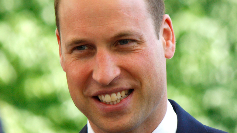 Prince William smiling at a royal event