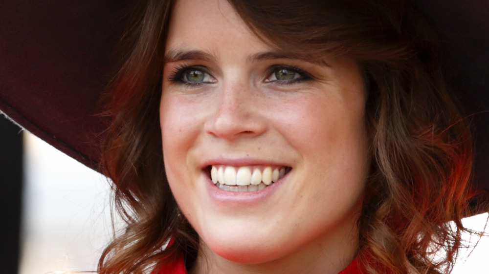 Princess Eugenie smiling in hat