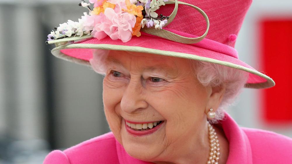 Queen Elizabeth wearing pink hat