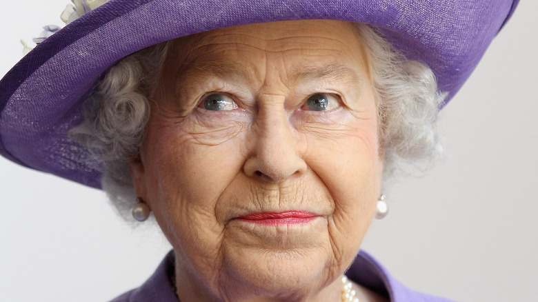 Queen Elizabeth dressed in lavender