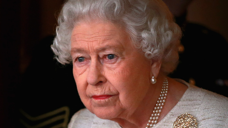 Queen Elizabeth wears white and pearls
