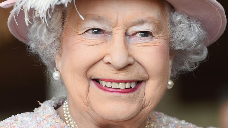 Queen Elizabeth smiling in pink