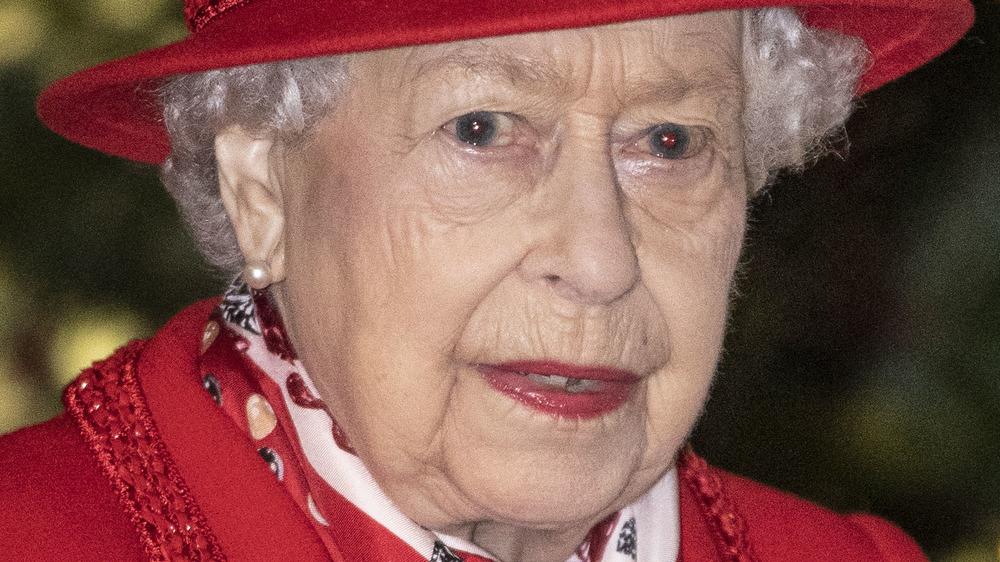 Queen Elizabeth II red hat
