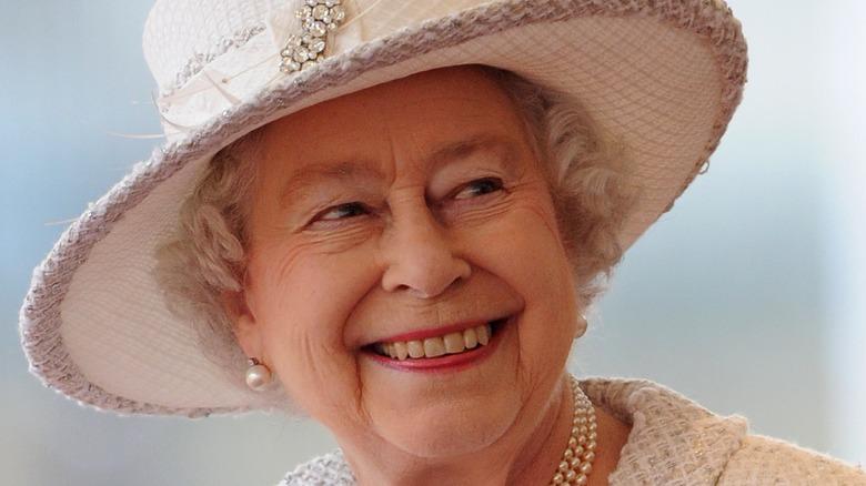 Queen Elizabeth white hat smiling