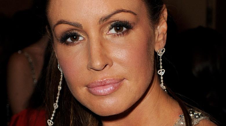 Rachel Uchitel wears long earrings and ponytail