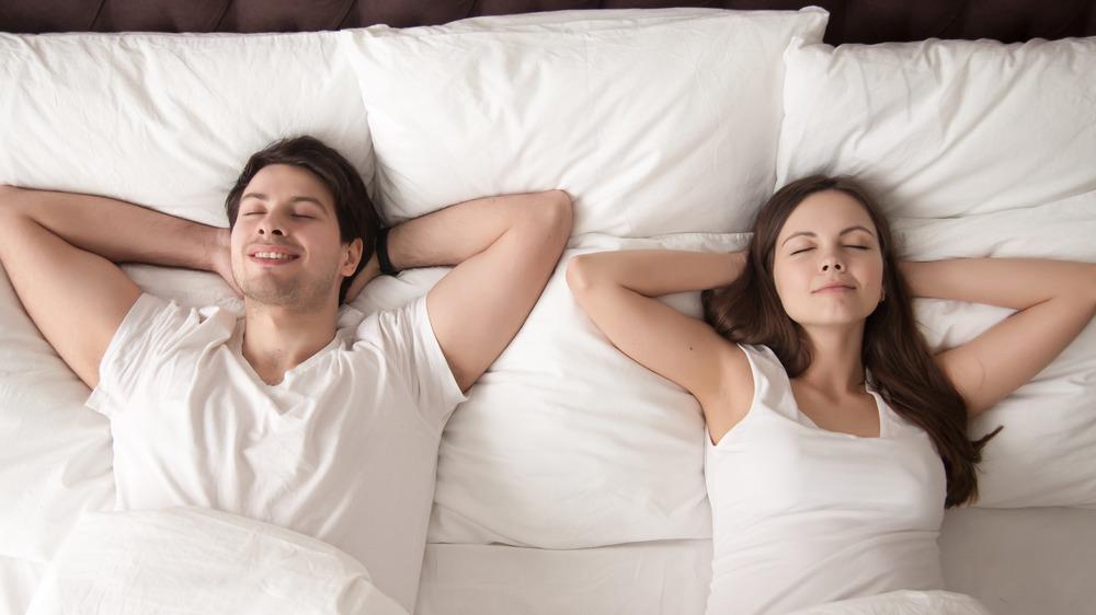 couple sleeping on generic mattress