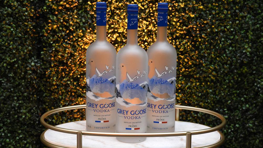Three bottles of Grey Goose vodka on a tray