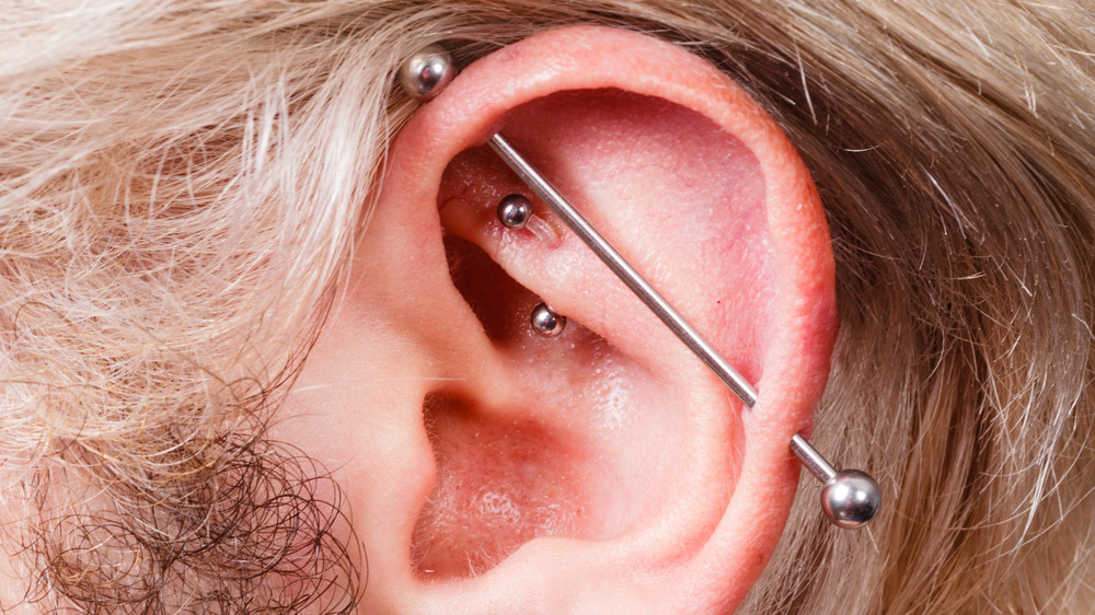 Close up of industrial piercings