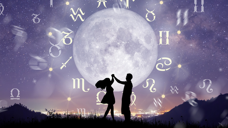 Zodiac signs, couple dancing under moon