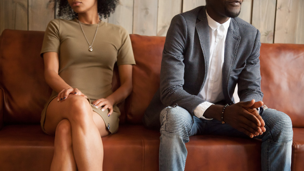 Tense couple sitting on couch
