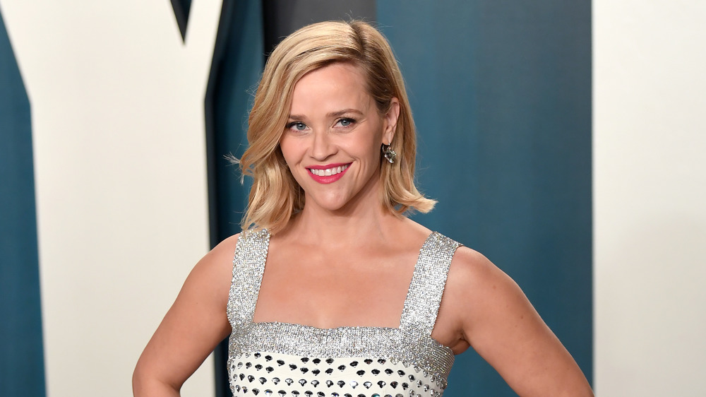 Reese Witherspoon smiles at event
