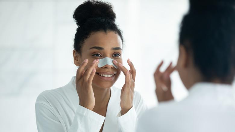 Woman applying pore strip