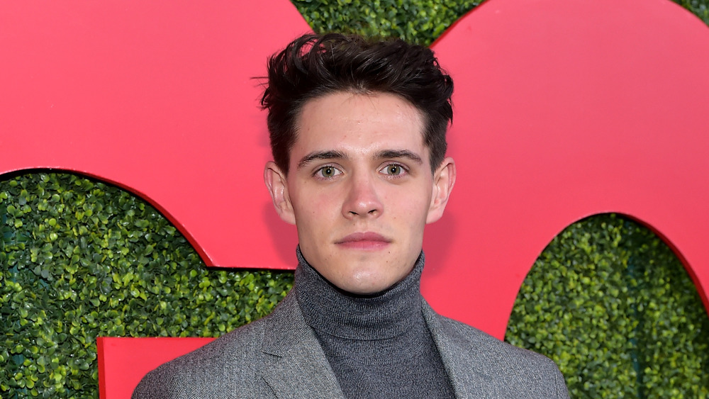 Riverdale star Casey Cott poses on the red carpet
