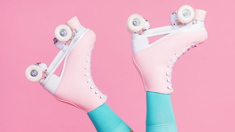 A pair of pink roller skates