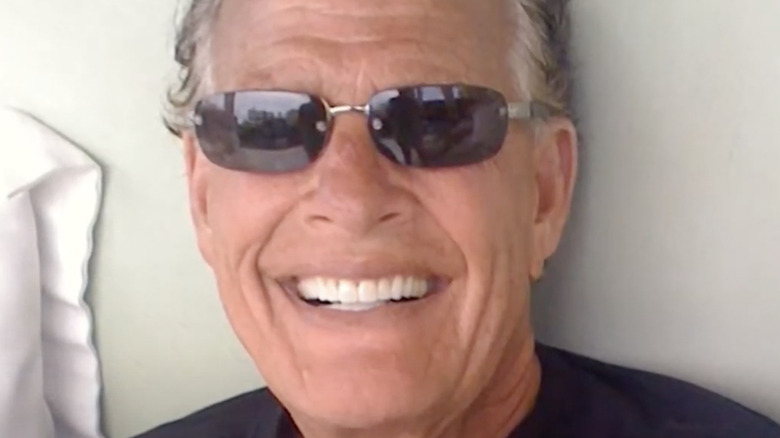 Ron Popeil smiling, shades