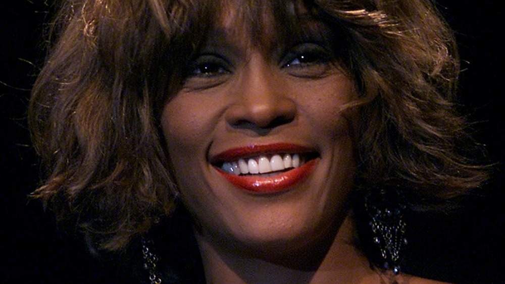 Smiling Whitney Houston in bob