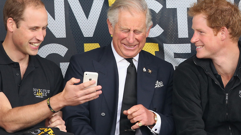 Prince Charles with sons William and Harry laughing