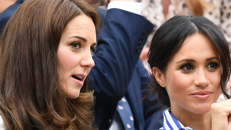Kate Middleton and Meghan Markle at an event.