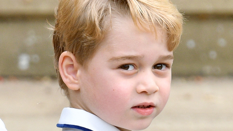 Prince George poses for the camera.