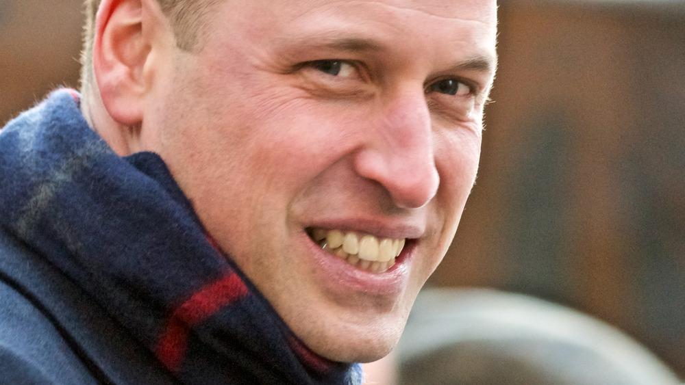 Prince William wearing scarf smiling