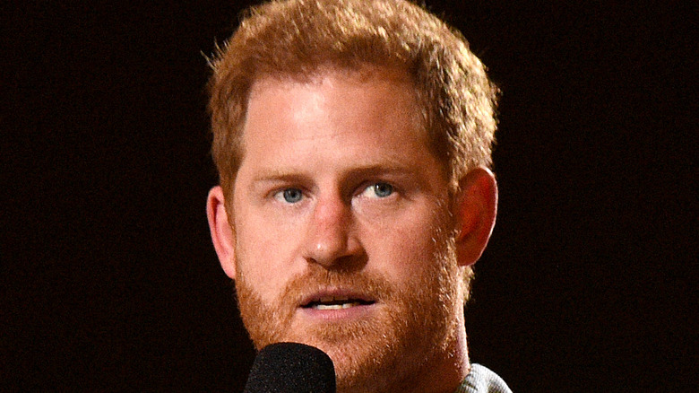 Prince Harry speaks onstage at the Vax Live event